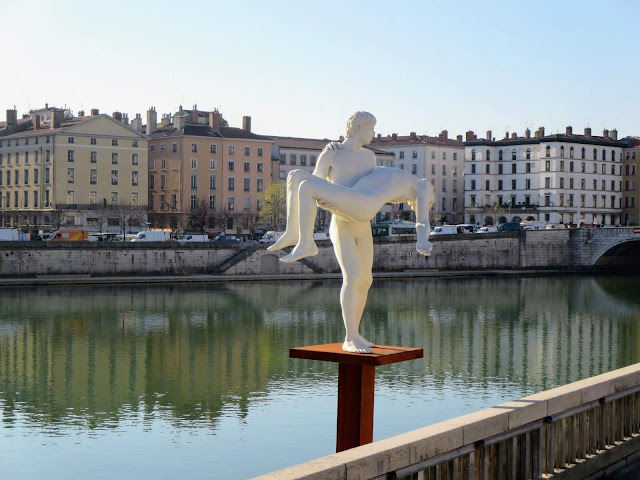 Things to do in Lyon France: Check out the sculptures along the Rhône River
