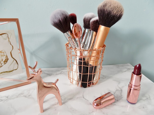 Copper make up brush holder with marble background