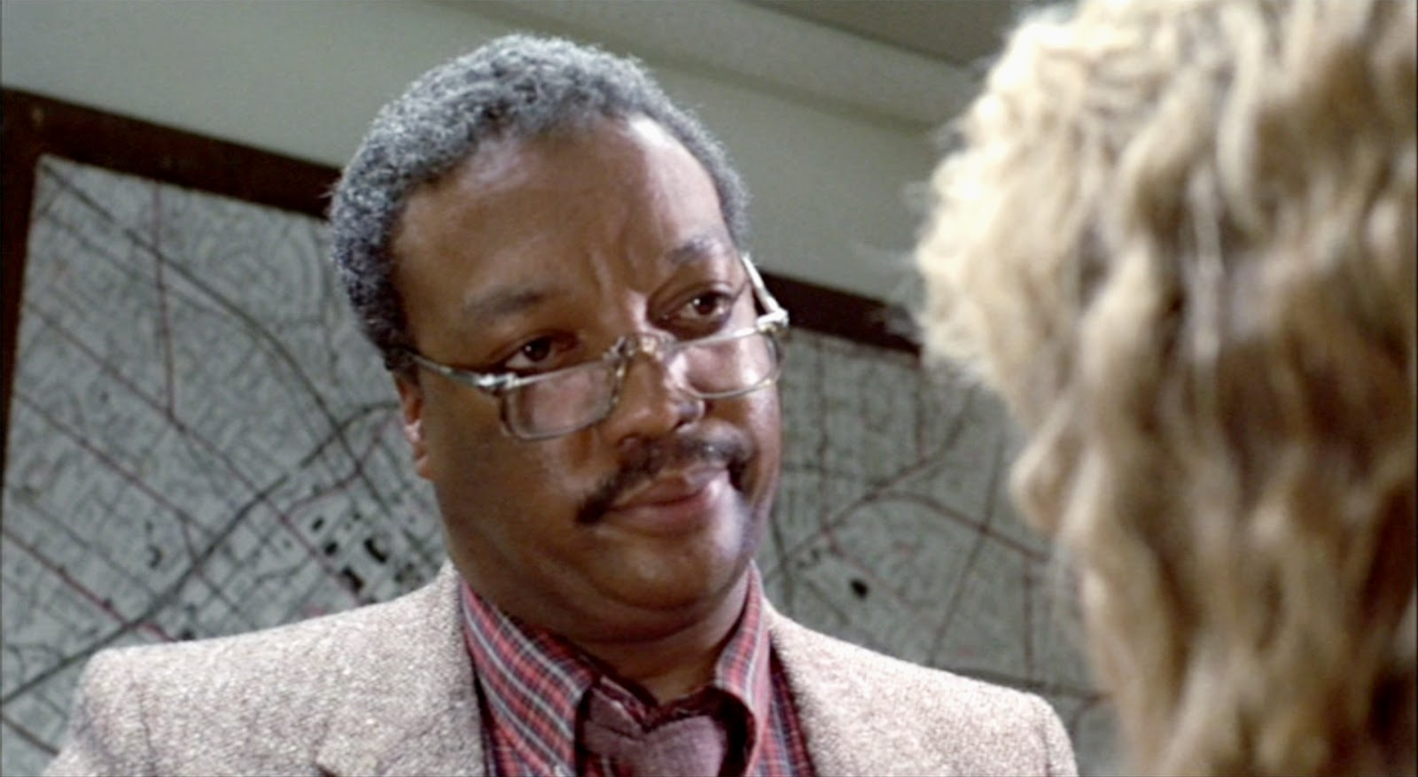 "Paul Winfield looking skeptically at Linda Hamilton in still from ""The Terminator"""