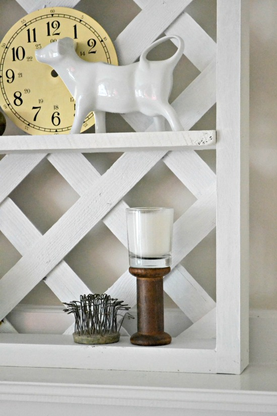 wooden lattice shelving with spool and cow