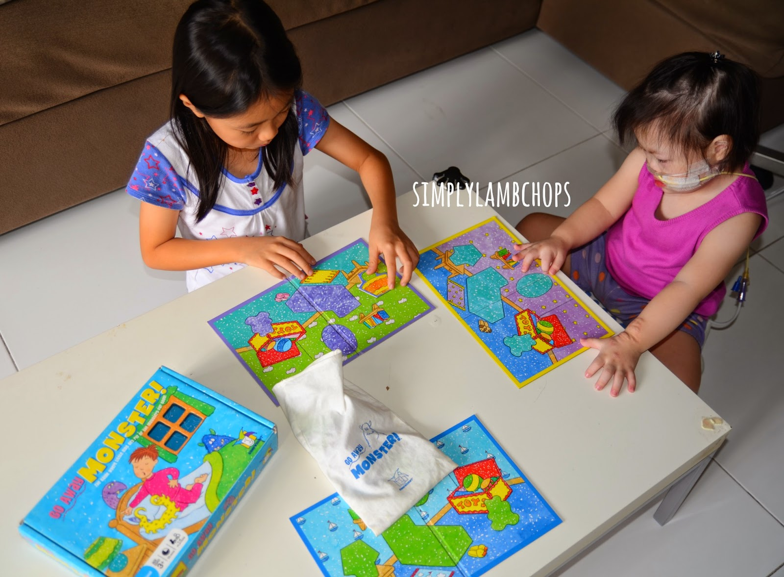 K loves Go Away Monsters board game from Simply Lambchops