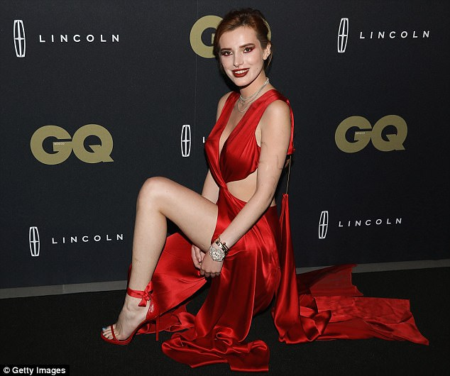 Bella Thorne flashes skin in scarlet gown at GQ Mexico Event