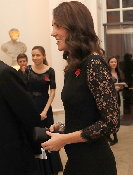 Kate Middleton wore DVF-Diane von Furstenberg Zarita gown. Queen's diamond pendant earrings, Prada clutch