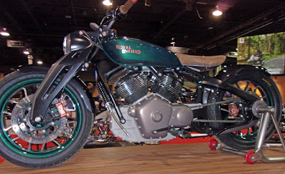 Big V-twin motorcycle on viewing stand.