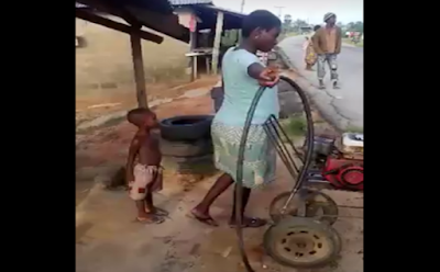 7 Months Pregnant Female Vulcanizer Spotted In Delta State (Photo, Video)