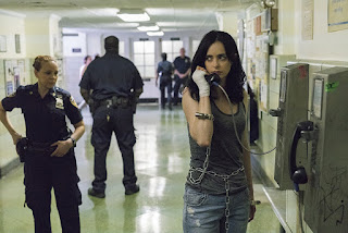 Jessica Jones on the phone at the police station.