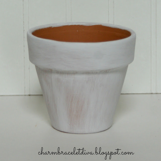 clay pot painted with gesso