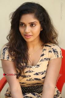 Telugu Actress Karunya Chowdary Stills in Short Dress at ATM Not Working Press Meet  0222.jpg