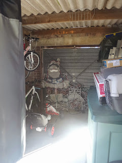 The Garage full of junk but great natural light!