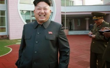 Kim Jong-un walks with a cane