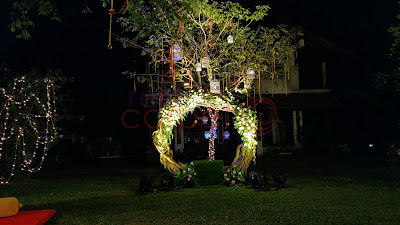 tree root with floral mehndi sangeet haldi decor kerala