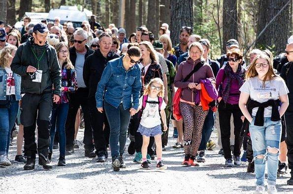Crown Princess met players and coaches of para football club of IFK Östersund. Adidas Terrex hiking shoes, Levis denim shirt