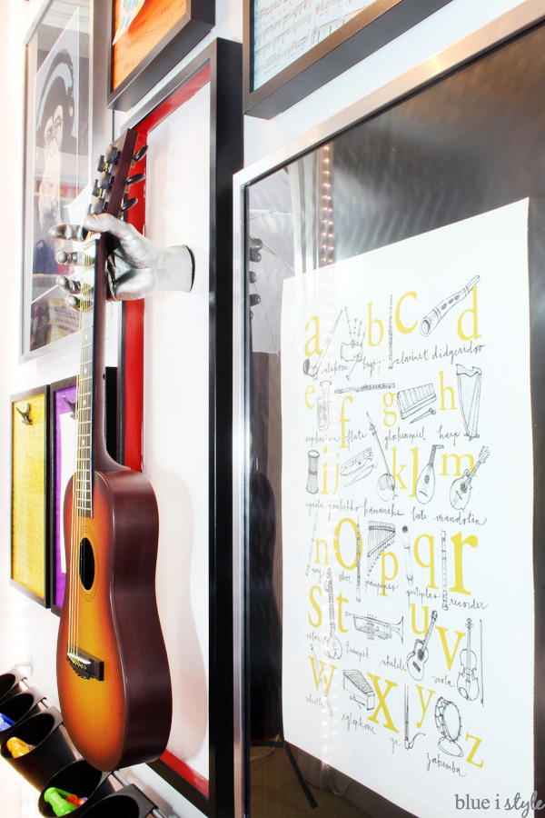 I love the music alphabet poster and he hanging guitar on rock & roll gallery wall in this playroom.