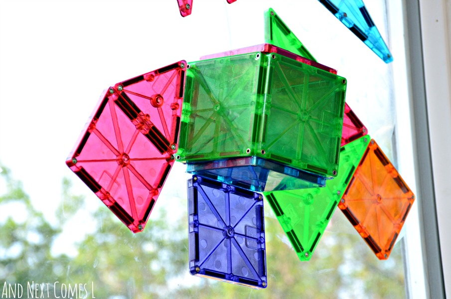Cube made from Magna-Tiles on a window from And Next Comes L