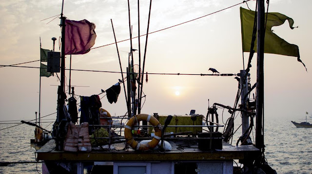 our world tuesday, upper deck, fishing boat, sassoon docks, mumbai, india, birds, flags, clothes, treasures, tube
