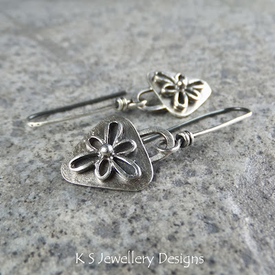 http://ksjewellerydesigns.co.uk/ourshop/prod_2941829-Sterling-Silver-Embellished-Flower-Triangle-Earrings.html