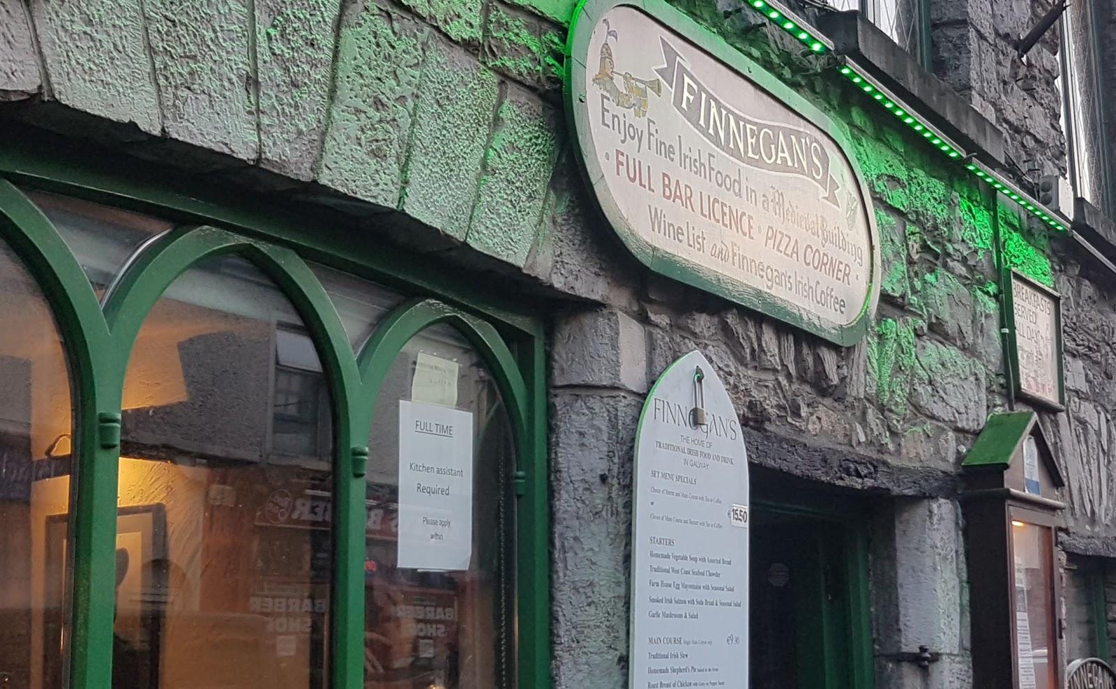 Finnegans - enjoy fine Irish food in a medievalbuilding - full bar licence - pizza corner - full wine list - Irish coffees - restaurant bright green lighting and arched windows