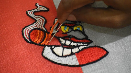 LOGO DESIGN WITH EMBROIDERY ART