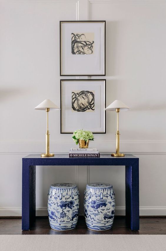 Blue console table with Chinoiserie stools underneath and modern art above - found on Hello Lovely Studio