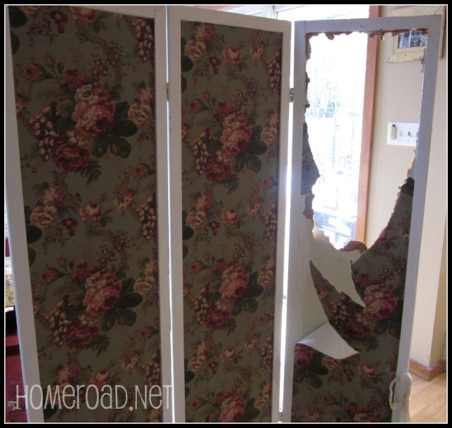Cabbage rose room divider with one panel torn down.
