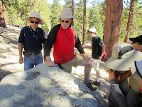 Looking at Native America mortar holes en route to Waterman Mountain