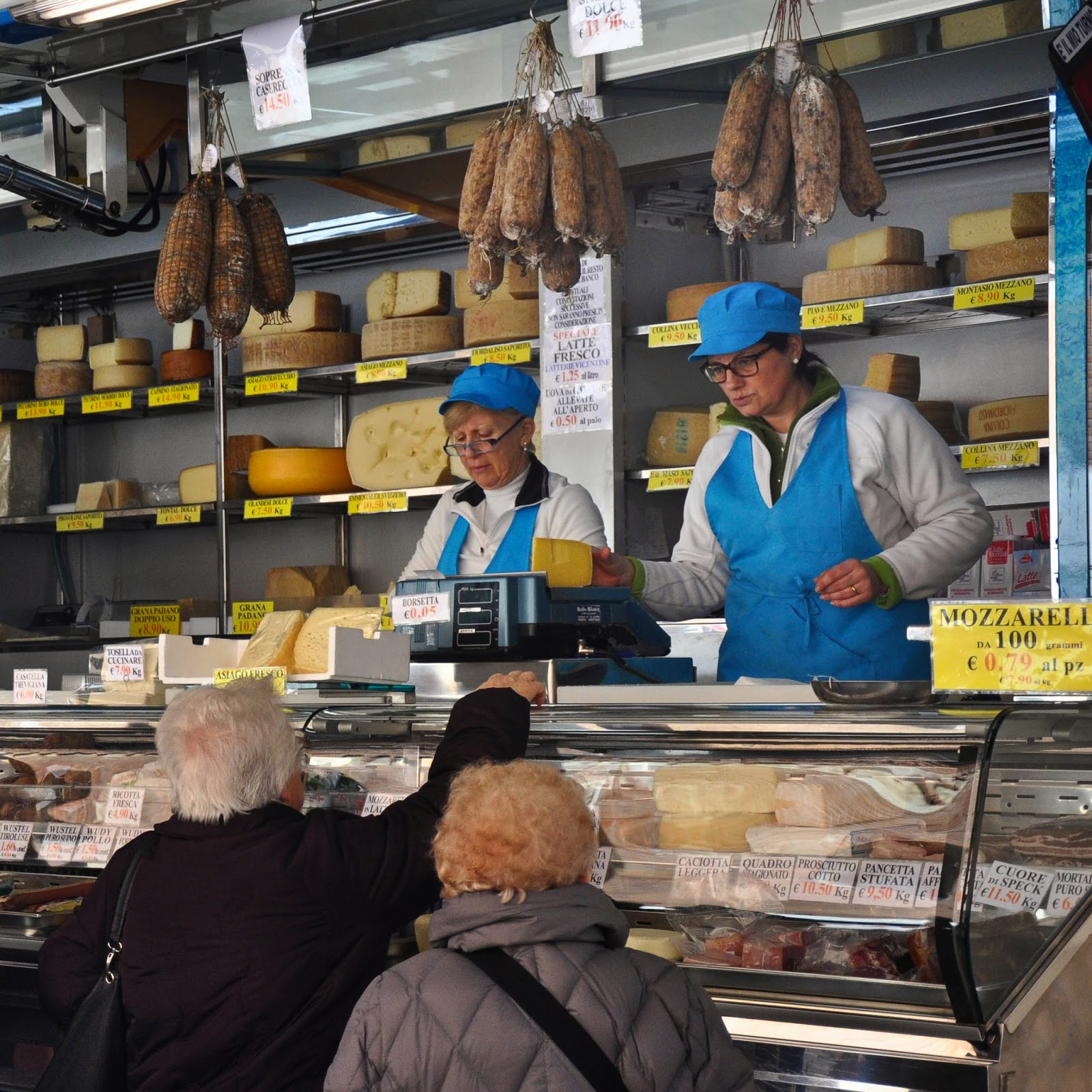 At the cheese and salumi stall at the Thursday market in Vicenza, Italy