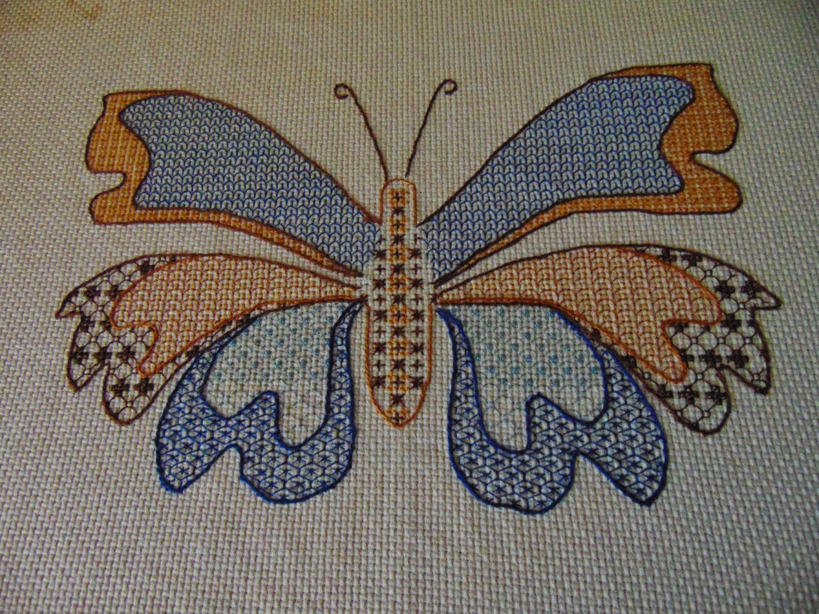 Redwork or blackwork butterfly in different colors and stitches