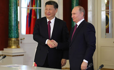 Vladimir Putin and Xi Jinping make press statements following the talks.