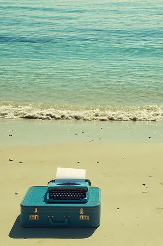 Typewriter on a beach