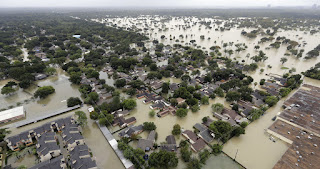 In this Tuesday, Aug. 29, 2017 file photo, a neighborhood near Houston's Addicks Reservoir is flooded after heavy rains from Tropical Storm Harvey. A study released Monday, Nov. 20, 2017 predicts that summer thunderstorms in North America will likely be larger, wetter and more frequent in a warmer world, dumping 80 percent more rain in some areas and worsening flooding. (Credit: AP Photo/David J. Phillip)  Click to Enlarge.