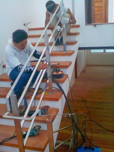 Stainless steel main stair and spiral stair railings at ...