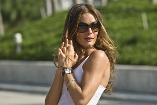 Burn Notice - FIona wearing sunglasses outside with hands clasps in front of her body