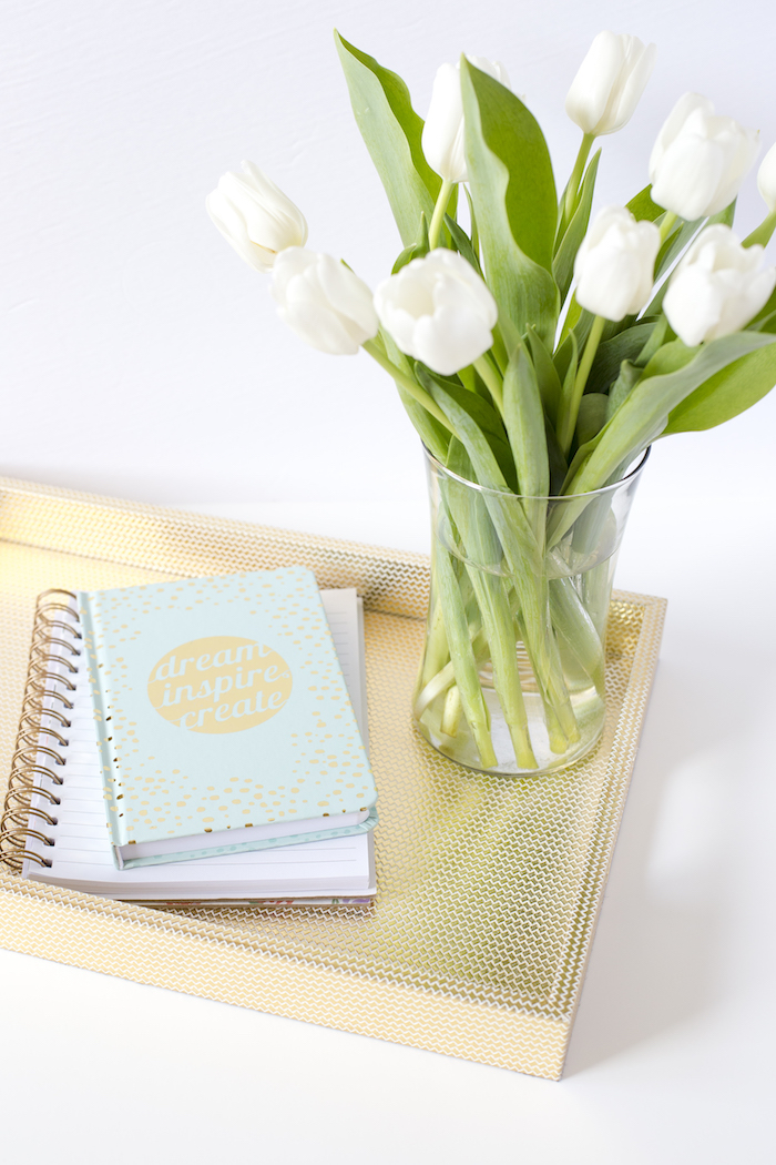 planner with tulips and gold tray