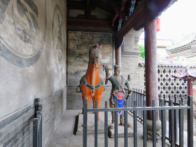 Statue of a man with horse at a temple in Pingyao, China