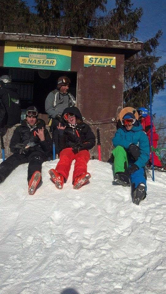 Three Skiers Sitting At Start Line