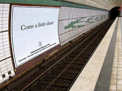 Funny funeral sign photo - come a little closer - tube station advert