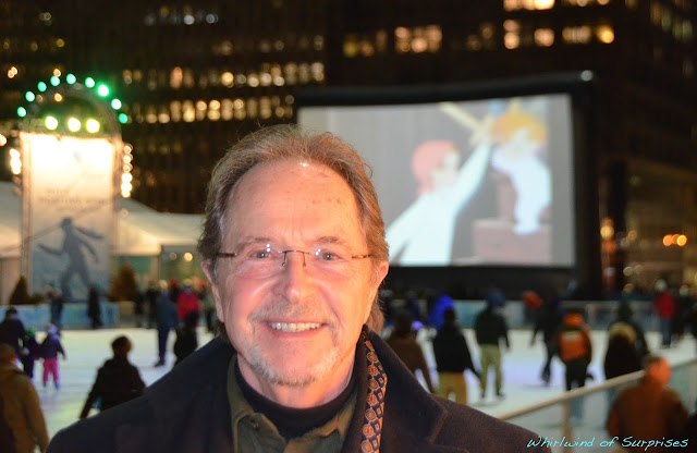 Paul Collins at Bryant Park in front of the screen showing his character, John Darling, sword fighting with his younger brother, Michael Darling. #PeterPanDiamond
