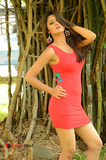 Actress Poojitha  Pictures in Red Short Dress at Bullet Movie Opening  0027.JPG