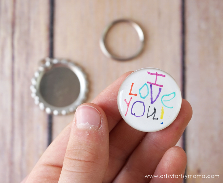 Mother's Day Bottle Cap Keychains are a creative craft for kids to make an awesome, custom keychain moms, aunts, and grandmothers are sure to love!