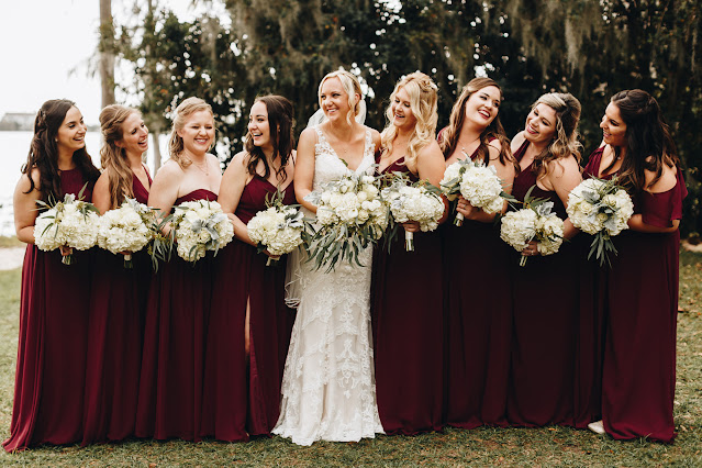 Bridal party in long maroon dresses