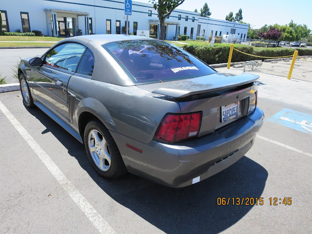 Old Mustang with faded paint and dents before repairs at Almost Everything Auto Body