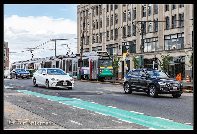 MBTA 3882 in traffic along Commonwealth Avenue in Boston.
