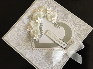 Hand made wedding card in white and silver with hearts and flowers
