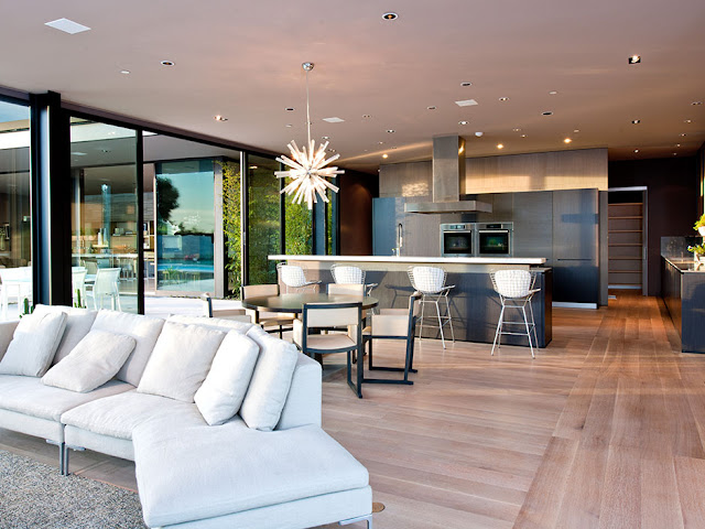 Photo of modern kitchen as seen from the living room of modern luxury Hollywood house