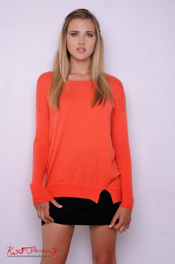 Contemporary fashion look for modelling portfolio, Mid shot with orange knit top, black skirt, Photography by Kent Johnson