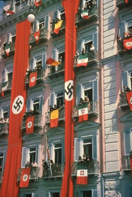 Swastika Italian flags color photos World War II worldwartwo.filminspector.com