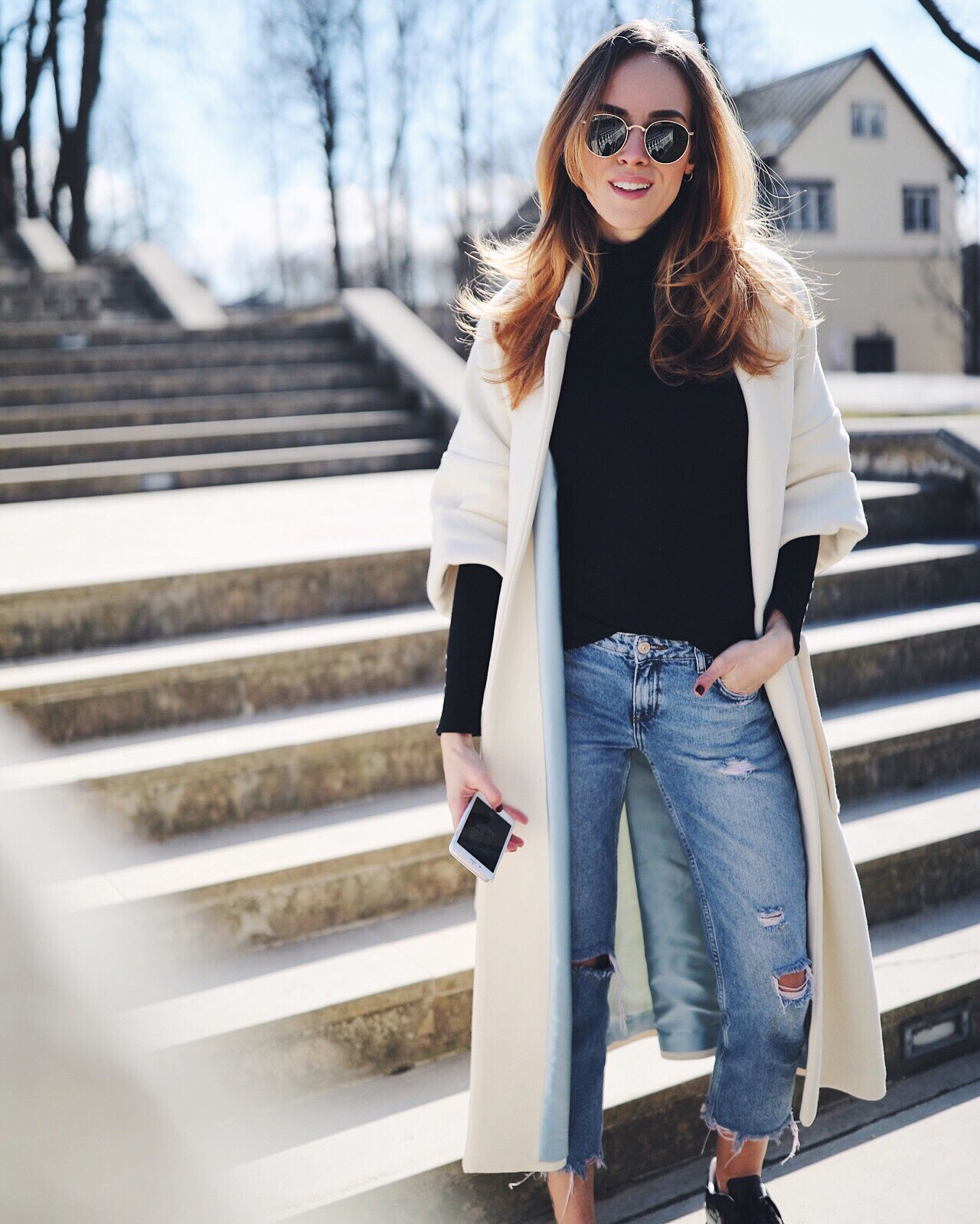 long coat jeans jumper sneakers spring outfit
