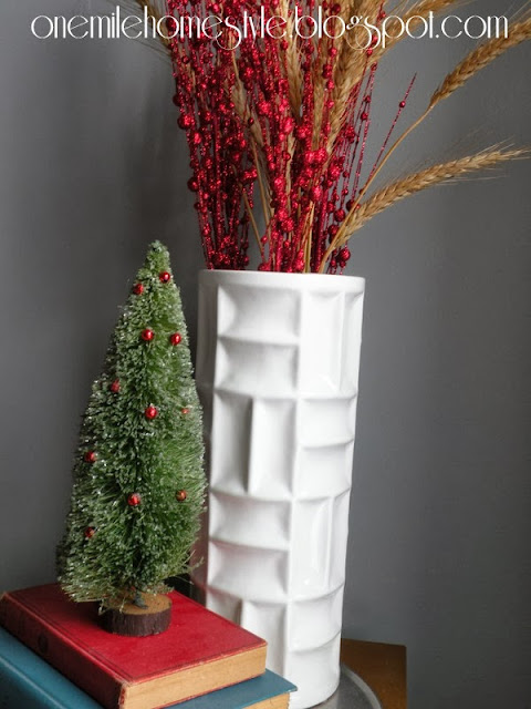 Red berries and wheat in a white vase - Christmas decor