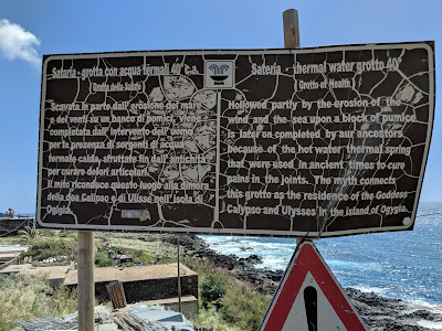 A weathered explanation sign at Grotta Sateria explaining that the water is 40 C - when it's open.