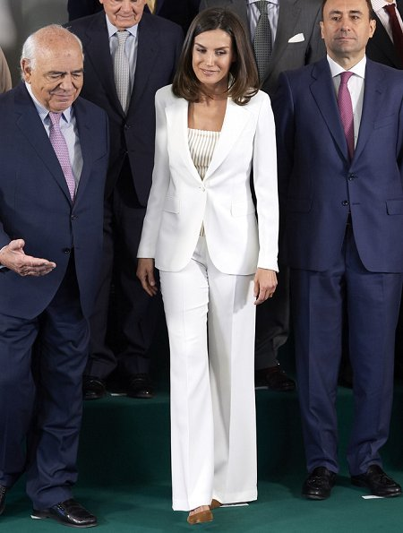 Queen Letizia looked radiant in white, debuting a crisp wide leg pantsuit by Carolina Herrera